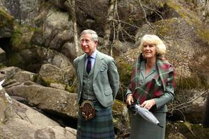 Charles and Camilla visiting Muir of Dinnet National Nature Reserve on Royal Deeside in Scotland in 2006 (David Cheskin/PA)