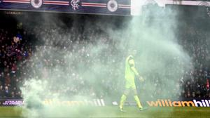 Celtic's Craig Gordon looks back after a smoke bomb was thrown onto the pitch during the Ladbrokes Scottish Premiership match at Ibrox Stadium, Glasgow