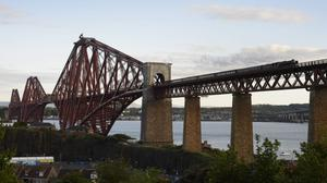 The new Queensferry Crossing joins two other iconic bridges across the Firth of Forth (John Linton/PA)