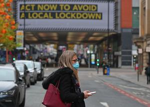 A woman wearing a face covering in Manchester city centre (Peter Byrne/PA)