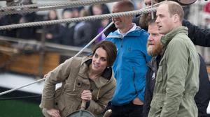 The Duchess of Cambridge steers the tall ship, Pacific Grace, watched by the Duke while sailing with members of the Sail and Life Training Society, at Victoria Inner Harbour in Victoria during the Royal Tour of Canada.