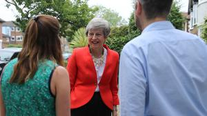 Prime Minister Theresa May meets with new parents and their children to discuss shared parental leave (Isabel Infantes/PA)