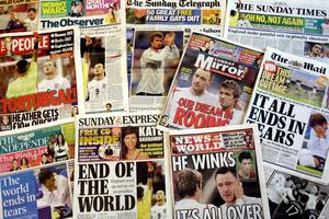 Newspaper headlines after England's quarter-final exit from the 2006 World Cup in a shoot-out against Portugal (Chris Young/PA)