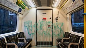 Undated handout photo issued by JBPR of Banksy's latest work sprayed on the inside of a London Underground tube carriage with messages about the spread of coronavirus.