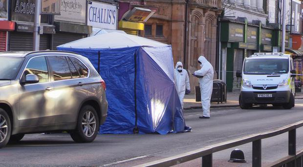 Police forensic officers attend the scene on Hessle Road in Hull (Dave Higgens/PA)