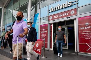 Passengers flying from Malaga arrive at Birmingham Airport (Jacob King/PA)