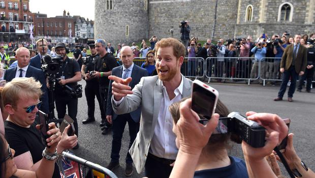 Prince Harry meets members of the public outside Windsor Castle the evening before his wedding (Simon Hulme/PA)