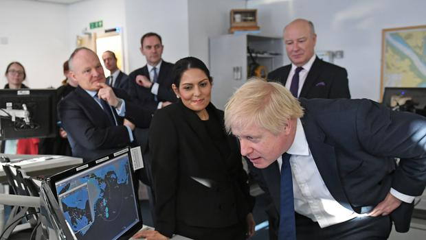 Prime Minister Boris Johnson alongside Home Secretary Priti Patel during a visit to the Port of Southampton (Stefan Rousseau/PA)