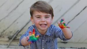 Prince Louis is photographed, making a handprint rainbow picture, to celebrate his second birthday (Duchess of Cambridge)
