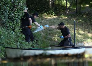 Police forensic officers gather evidence near the boats by the lake in the grounds of Lullingstone Castle in Eynsford, Kent (Yuik Mok/pA)