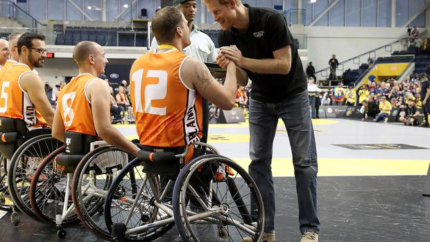 Prince Harry congratulates the competitors at the wheelchair basketball in Toronto (PA)