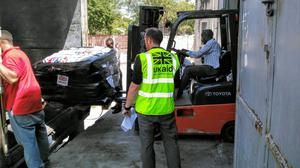 UK aid being offloaded after it arrived in Haiti, including shelter kits for 5,000 people (Julien Mulliez/DFID/PA)