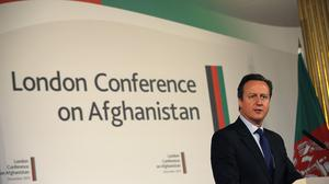 Britain's Prime Minister David Cameron speaks during a press conference at the London Conference on Afghanistan, in London.