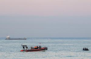 French authorities dealing with migrant crossings (Prefecture Maritime Manche et Mer du Nord/PA)