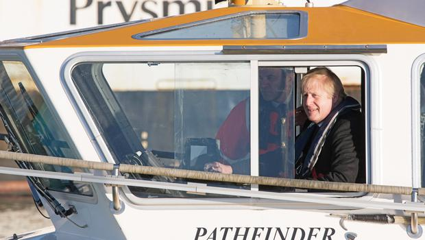 Boris Johnson seemed to enjoy his boat trip (Stefan Rousseau/PA)