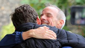 Norman Cook hugs his son after his good news (Gareth Fuller/PA)