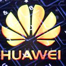 In camera multiple exposure photograph shows the Huawei logo and the keys of a keyboard, as the UK government is set to decide to what extent Chinese tech giant Huawei will be allowed to help build new 5G infrastructure.