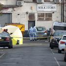 Police and forensic officers at the scene in Seven Kings, Ilford, east London (Jonathan Brady/PA)