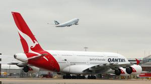 Qantas will operate the temporary flight this week (Steve Parsons/PA)