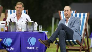 The Duke of Cambridge sits with former Arsenal player Tony Adams (Tim Merry/Daily Express/PA)