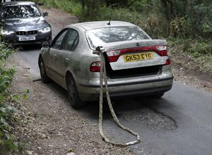 The Seat Toledo with tow rope and the police car as they would have been positioned at the initial confrontation in Admoor Lane, Berkshire (Steve Parsons/PA)