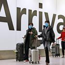 Passengers in the arrivals concourse at Heathrow Terminal 4 (Steve Parsons/PA)