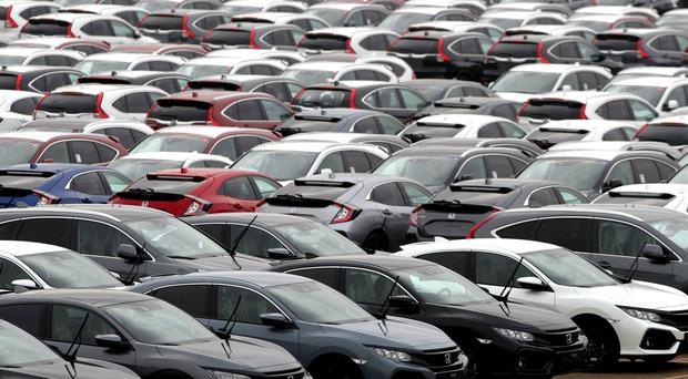 Business and trade union leaders have criticised plans for a workplace parking levy (Andrew Matthews/PA)