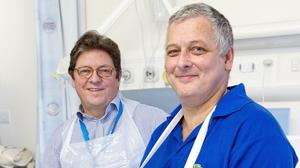 Mark Cahill, right, became the first person in the UK to have a hand transplant