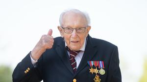 Captain Sir Tom Moore is to be knighted (Joe Giddens/PA)