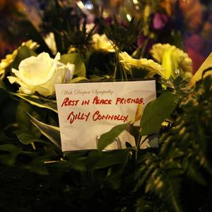 Flowers left by comedian Billy Connolly near the Clutha bar helicopter crash scene in Glasgow.