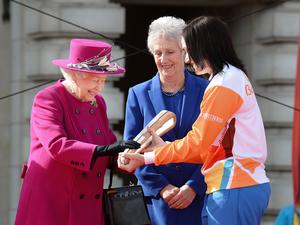 (From the left) The Queen, with Louise Martin, President of the Commonwealth Games Federation, and Anna Mears, the Australian cycling gold medallist, launches the Queen's Baton Relay for the XXI Commonwealth Games, last year. (John Stillwell/PA)