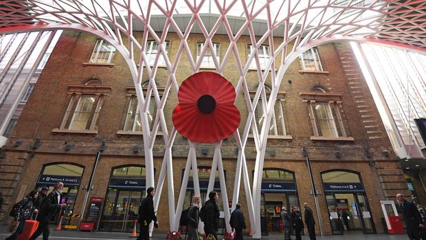 A large model of a poppy over King's Cross St Pancras Station in London (Kirsty O'Connor/PA)