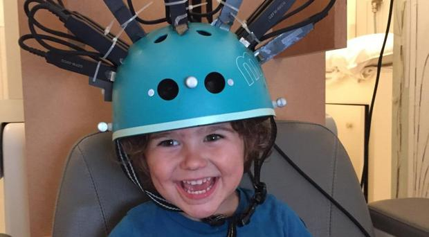 The new 'bike helmet' brain scanner being used with children for the first time (Rebeccah Slater/PA)