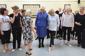 Camilla learning a step from Angela Rippon after watching a Silver Swans class at the Royal Academy of Dance in Battersea, London in 2018 (Eddie Mulholland/Daily Telegraph/PA)