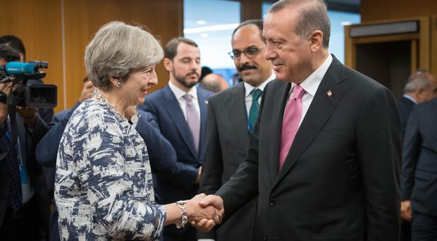 Theresa May has urged Turkish President Recep Tayyip Erdogan to protect civilians in his offensive against Kurdish militia in Syria (Stefan Rousseau/PA)
