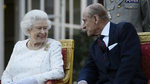 The Queen and Duke of Edinburgh at a garden party in France (Owen Humphreys/PA)