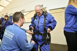 D-Day veteran Harry Read, 94, is helped into his skydiving harness at Old Sarum Airfield, Salisbury, Wiltshire (Ben Birchall/PA)