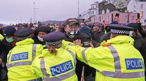 Police restrain drivers trying to enter the Port of Dover (Steve Parsons/PA)