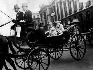 Queen Mary, Princess Elizabeth and the Duchess of York travel to the Trooping of the Colour celebrations in 1931 (PA)