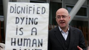 Assisted Suicide Bill supporter Patrick Harvie speaks at a display outside Holyrood in 2015 (Andrew Milligan/PA)