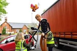 A customised balloon of Captain Tom was among the items delivered to the centenarian (Jacob King/PA)