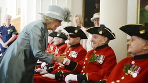 The Duchess of Cornwall meets Chelsea Pensioners on Founder's Day in 2013 (Bethany Clarke/The Times/PA)
