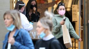 People wear a mask as they leave a shop in Buchanan Street in Glasgow (Andrew Milligan/PA)