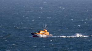 Lifeboat crews rescued the people in two cars (Steve Parsons/PA)