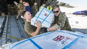 RAF personnel and charity workers offloading aid from a RAF A400M Atlas aircraft at Beira International Airport in Mozambique for survivors of cyclone Idai (Cpl Tim Laurence RAF/MoD/PA Images).