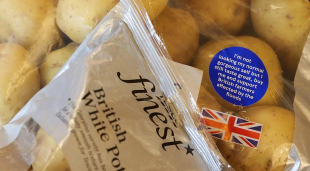 A bag of Tesco potatoes featuring the blue sticker in support of flood-hit potato farmers (Tesco/PA)