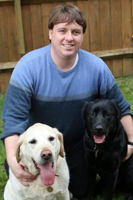 Frankie Tipton with Victoria and his previous guide dog, Bentley (left) (Thames Water/PA)