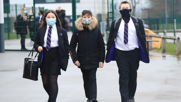 Children arrive at Outwood Academy in Woodlands, Doncaster (Danny Lawson/PA)