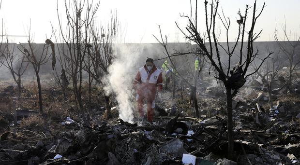 Rescue workers search the scene where an Ukrainian plane crashed in Iran (AP Photo/Ebrahim Noroozi)