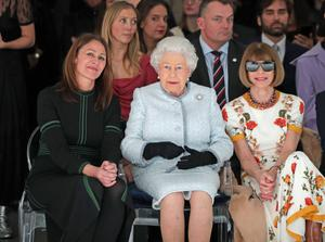The Queen wearing the Cullinan V brooch in the front row of a catwalk show at London Fashion week with Anna Wintour (Yui Mok/PA)